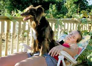 Au Pair Dog Carers Rebekah sitting on Anna in the sun